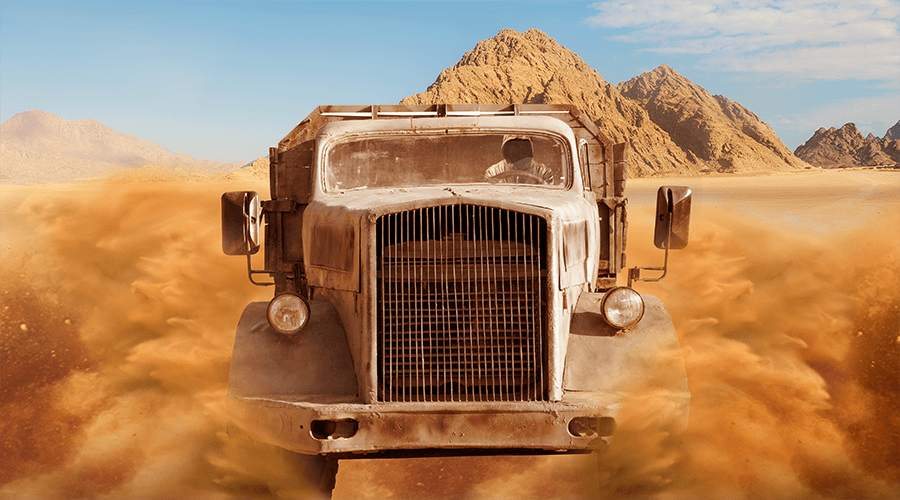 A truck running in the desert like a scene in the movie Mad Max Fury Road