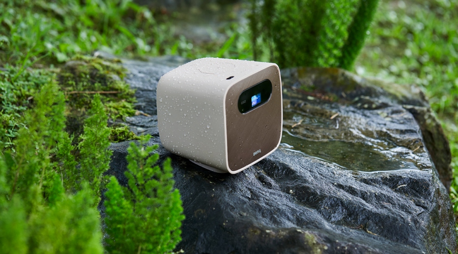 An outdoor portable projector on the rock in the rain