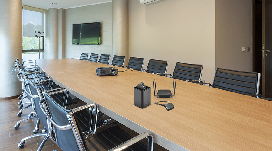 A conference room with BenQ InstaShow wireless presentation system on the table