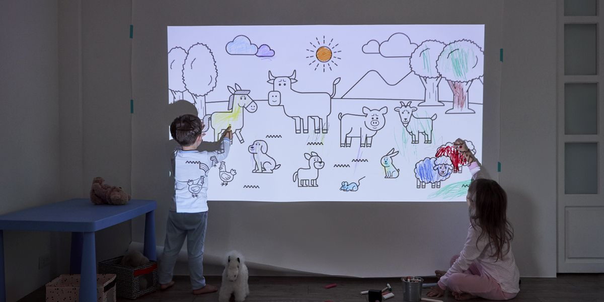 Kids drawing on a wal using a projector