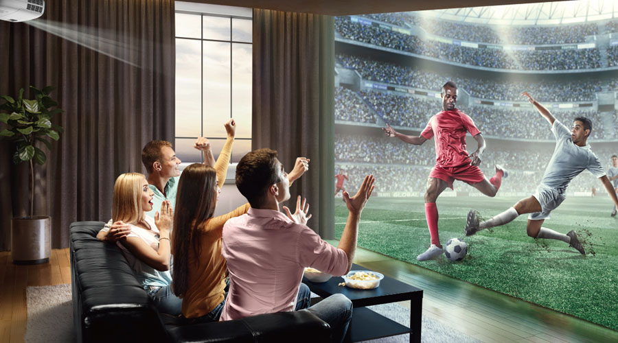friends get together in a living room to enjoy football game playing on a projector
