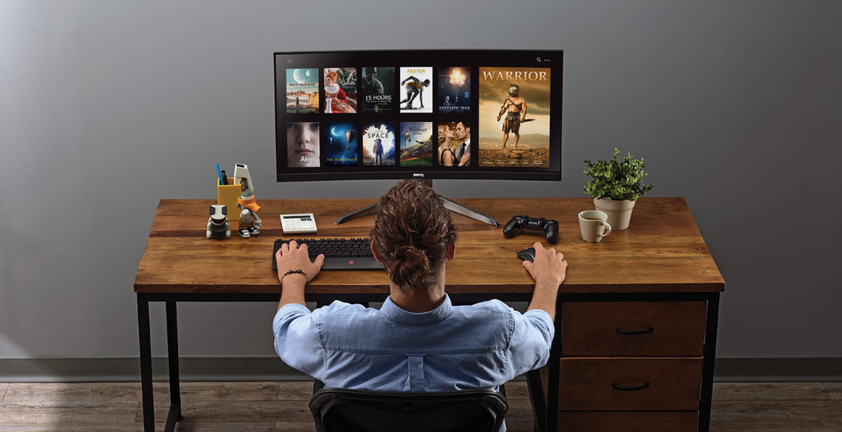 Man enjoys watching streaming and movies via BenQ Video Enjoyment Montior