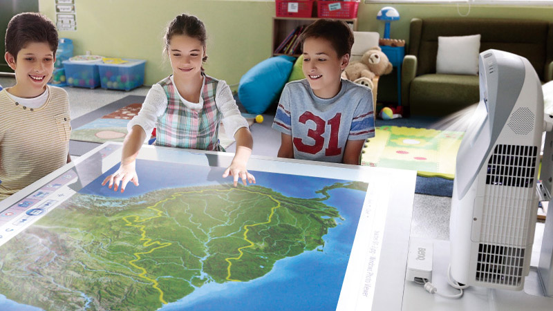 children with the map projected by an interactive BenQ projector in classroom